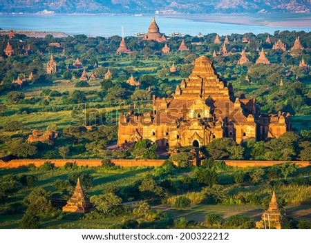 Ancient pagodas in Bagan with altitude balloon Myanmar - stock photo