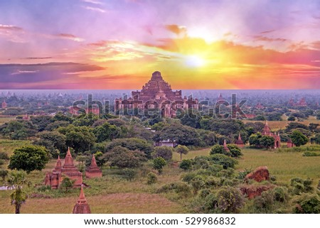 Ancient pagodas in the landscape from Bagan in Myanmar at sunrise In the middle the Dhammayangyi Temple, The biggest of all temple in Bagan.