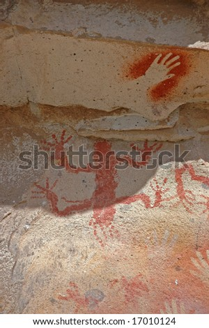 Ancient Painting, Human Hand and Mystery Being - stock photo