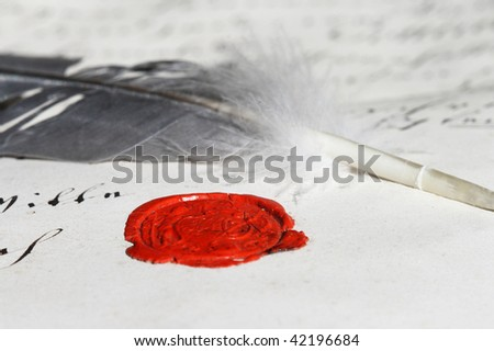 Ancient parchment manuscript with wax seal and feather - stock photo
