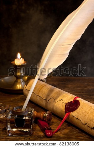 Ancient parchment or diploma scroll with wax seal and quill pen - stock photo