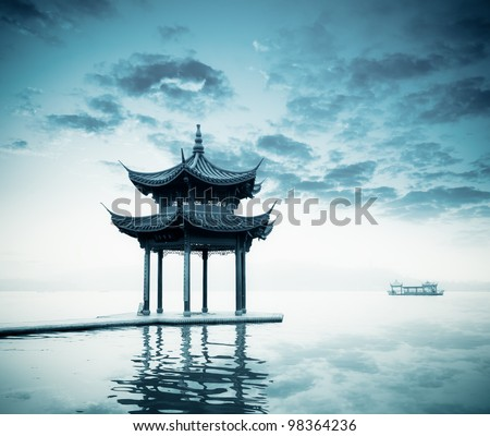 ancient pavilion on the west lake in hangzhou,China. - stock photo