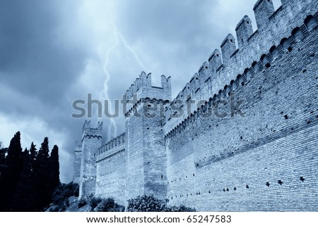 ancient perimeter walls of the fortress under cloudy sky - stock photo