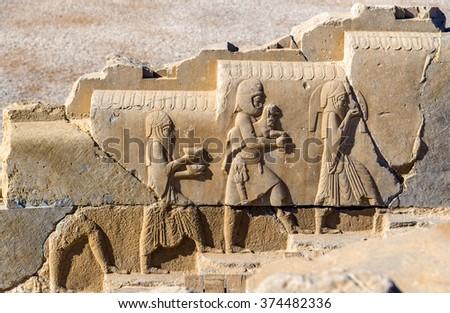 Ancient persian bas-relief in Persepolis - Iran - stock photo