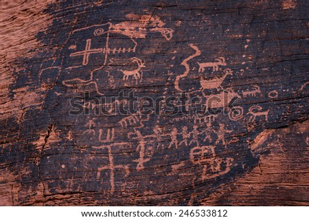 ancient petroglyphs fount on the walls of the the Mouse's Tank hiking trail in Valley of Fire State Park, Nevada - stock photo