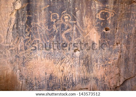 Ancient petroglyphs on a rock formation in South Dakota - stock photo