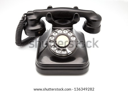ancient phone on white fund - stock photo