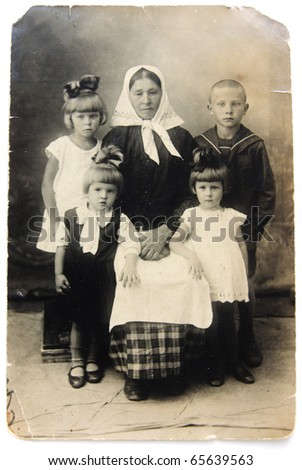 Ancient photo of grandmother with children, circa 1930