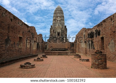 Ancient prang in Ayutthaya of Thailand, with blue sky - stock photo