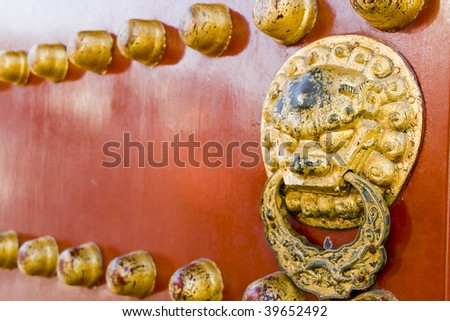 Ancient red Temple door in beijing china