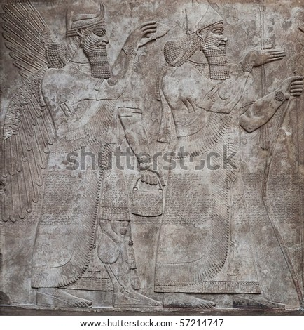 Ancient relief of assyrian gods - stock photo