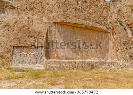 Ancient relief of the necropolis Naqsh-e Rustam that shows the ordination of Narseh by goddess Anahita, Iran, Sasanian civilization 4th century AD. - stock photo