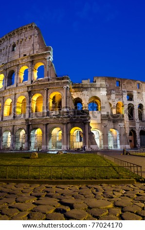 Ancient roman colosseum at dusk, Rome, Italy - stock photo