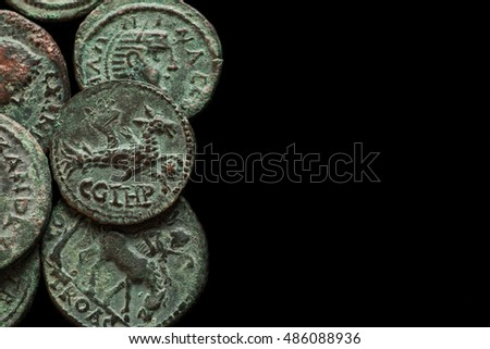 Ancient roman copper coins with different images, isolated on black, text space