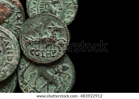 Ancient roman copper coins with different images, isolated on black, text space, overhead view
