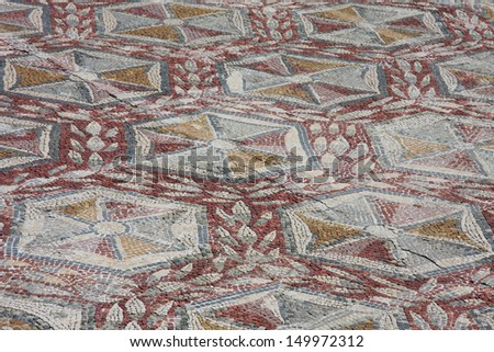 Ancient Roman mosaic in the Roman ruins of Conimbriga, Portugal. 1st to 2nd centuries. - stock photo