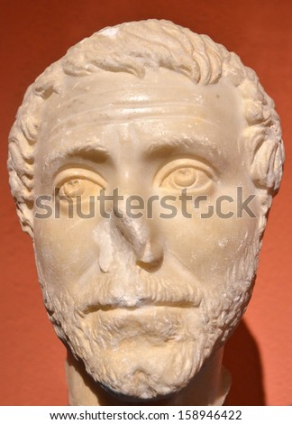 Ancient roman sculpture in marble of the head of a man with a sad expression