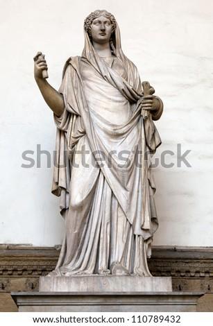 Ancient Roman sculpture of a Vestal Virgin at the Loggia dei Lanzi, Florence, Italy - stock photo