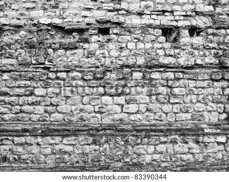 Ancient Roman wall ruins in London UK - stock photo