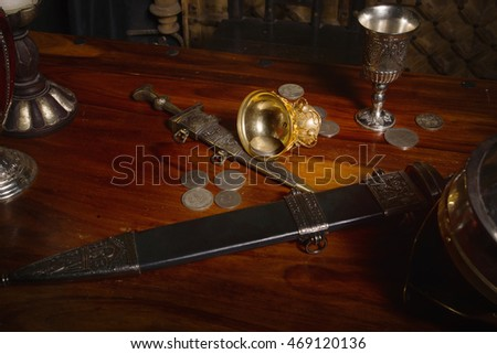 Ancient Rome concept. Gladius, antique hand weapon, helmet on a table
