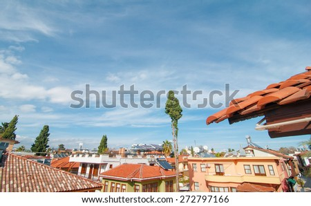 Ancient roofs and blue sky at sunny day  - stock photo