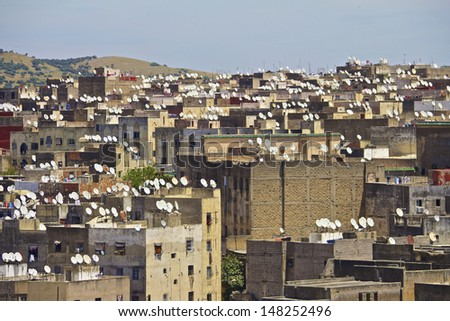 Ancient rooftops of Fez medina with modern satellite dishes - stock photo