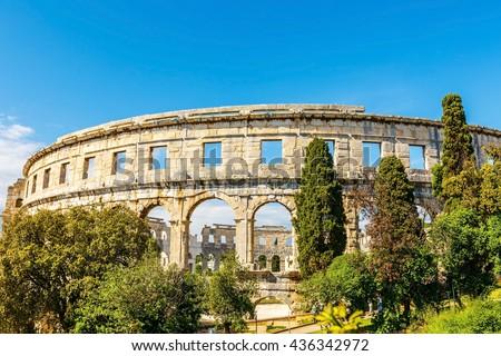 Ancient ruin of Roman Pula arena, daytime, Adriatic sea of Croatia - stock photo