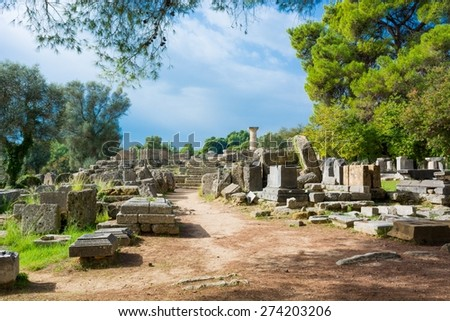 Ancient ruins of a temple. Ancient Olympia, Unesco world heritage. - stock photo