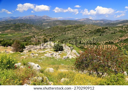Ancient ruins of Mycenae spread on sunny hills of Peloponnese, Greece