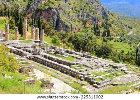 Ancient ruins of the temple dedicated to Greek god Apollo at Delphi, Greece - stock photo