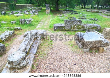 Ancient ruins on the ground at Olympia, Greece - stock photo