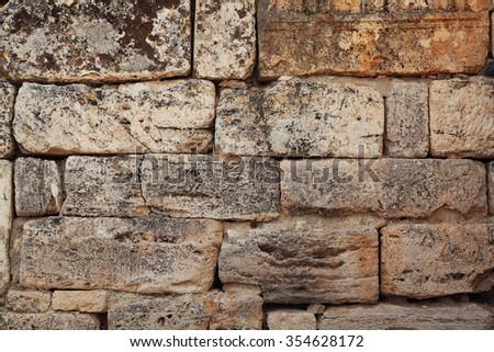 Ancient sandstone masonry texture - stock photo