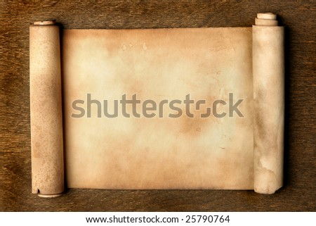 Ancient scroll on wooden table close up - stock photo
