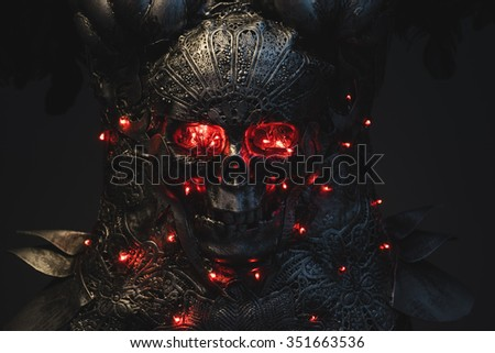 Ancient silver armor skull with red eyes and led lights, helmet metal filigree - stock photo