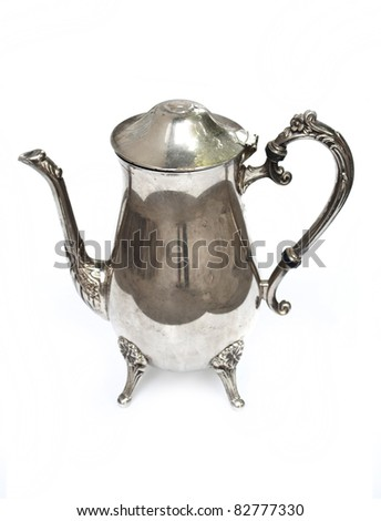 ancient silver tea pot on white background