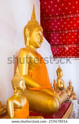 Ancient smiling buddha at Thai temple, Thailand. - stock photo