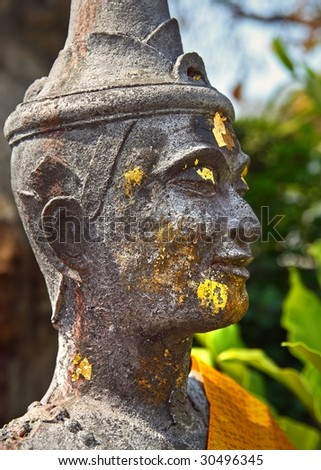 ancient statue face in thailand - stock photo