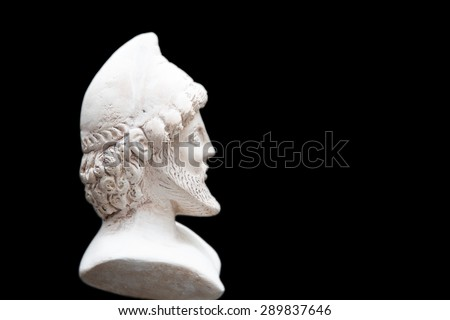 Ancient statue of Odysseus isolated on a black background. Odysseus  also known by the Latin name Ulysses  was a legendary Greek king of Ithaca and a hero of Homer's epic poem the Odyssey.  - stock photo