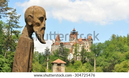 Ancient statue overlooks Bran Castle also known as Dracula's Castle - stock photo