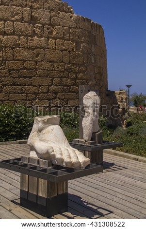 Ancient statues and marine artifacts in harbor of Caesarea .Caesarea Maritima was a city and harbor built by Herod the Great about 25-13 BC.Today,its ruins on the Israel Mediterranean coast