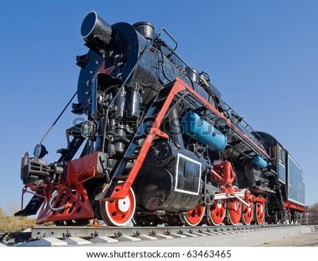 Ancient steam locomotive - stock photo