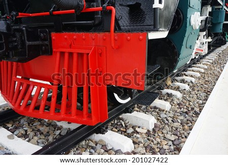 Ancient steam train placed on the tracks, displayed to the audience.                                     - stock photo