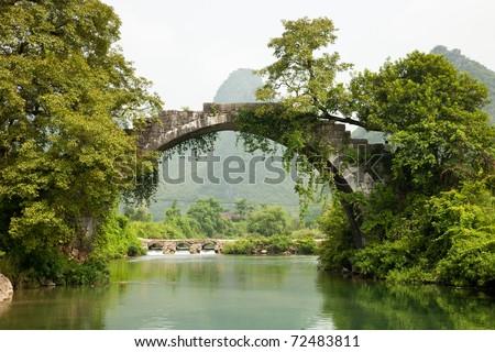 Ancient stone bridge - stock photo