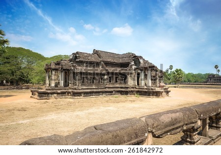 ancient stone building in angkor wat site - stock photo