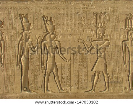 Ancient stone carved Egyptian hieroglyphics in Egypt - stock photo