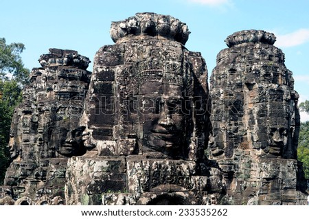 Ancient stone faces of Bayon temple, Siemreap, Cambodia - stock photo