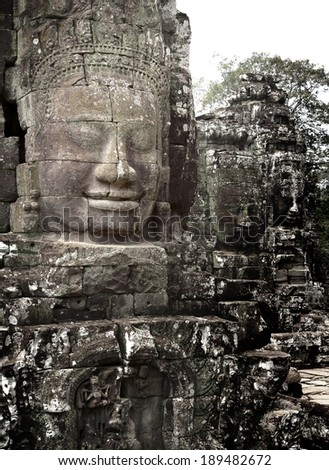 Ancient stone  head of Bayon Tample in Angkor Thom, Cambodia, South East Asia. Tradition, Culture and Religion. - stock photo