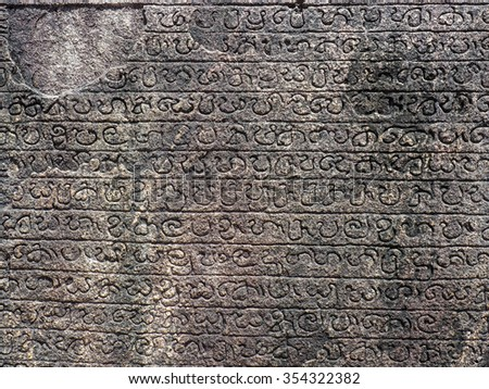 Ancient stone inscriptions in Singalese language texture. Pollonaruwa, Sri Lanka - stock photo