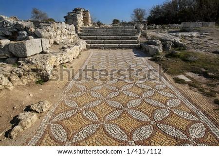 Ancient stone mosaic at destroied basilica in antique greece city Hersones in Sevastopol, Crimea - stock photo