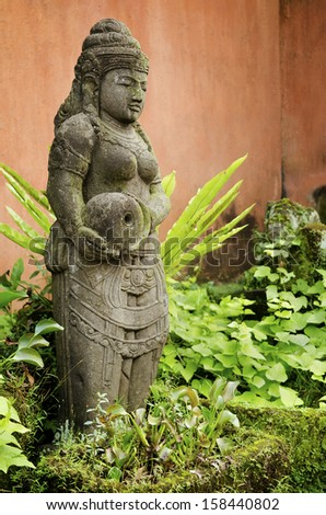 ancient stone statue in bali indonesia